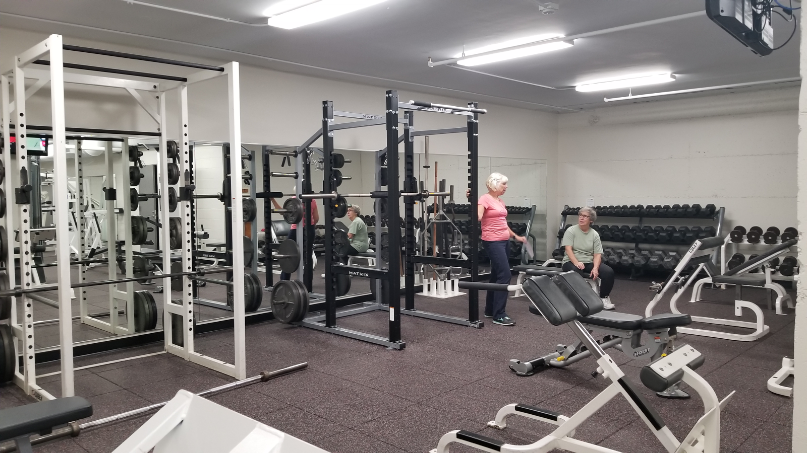Strength Room with strength training machines and free weights.