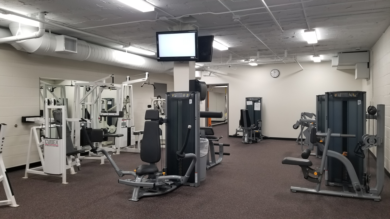 Weight room, weight machine area.